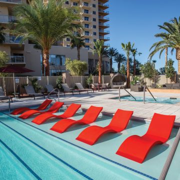 Lounge chairs in the shallow end of the pool at One Las Vegas