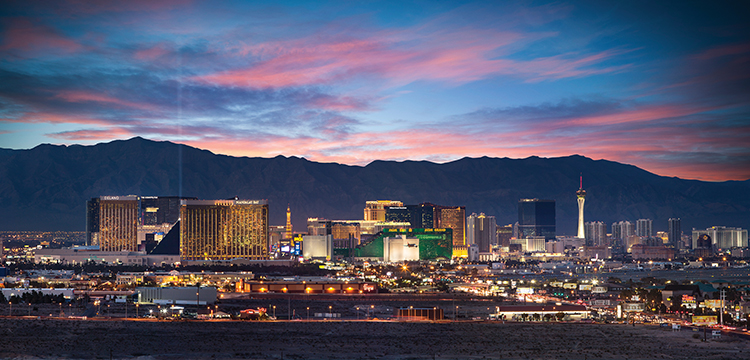 Distant view of the Strip at night with the mountains in the background