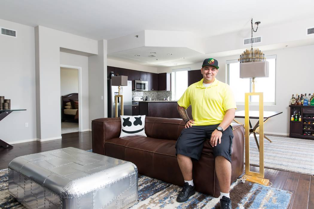 Resident Corey Daniel sitting in his living room at his One Las Vegas home