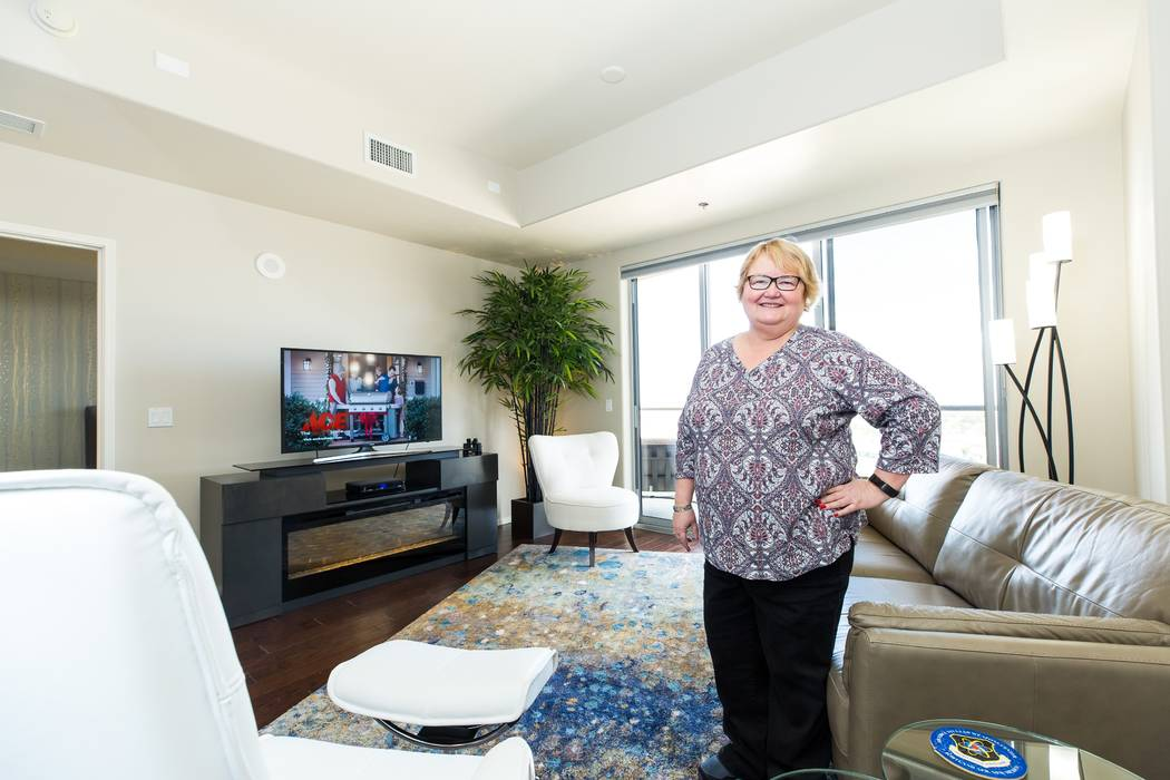 One Las Vegas resident Pat Pettit standing in her living room