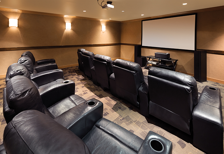 Movie theater, equipped with lounge chairs and big screen TV, available at One Las Vegas.