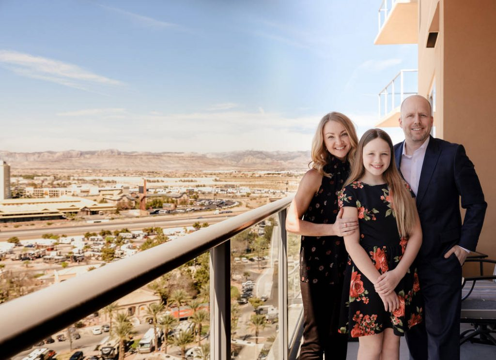 The Saye family standing on the balcony of their One Las Vegas home