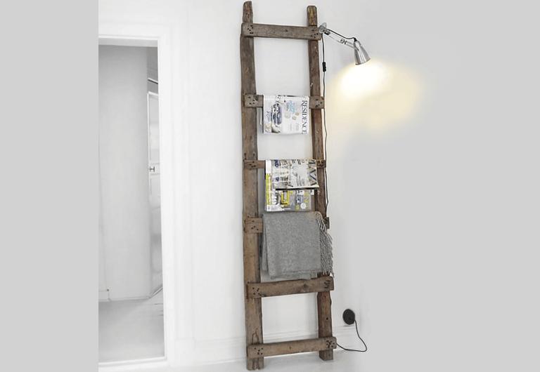 DIY project using ladder as storage and decoration.