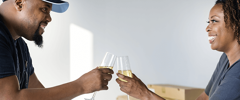 Happy couple celebrating their condo lifestyle with champagne.
