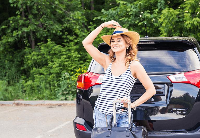 Happy traveler enjoying her lock-and-leave lifestyle.