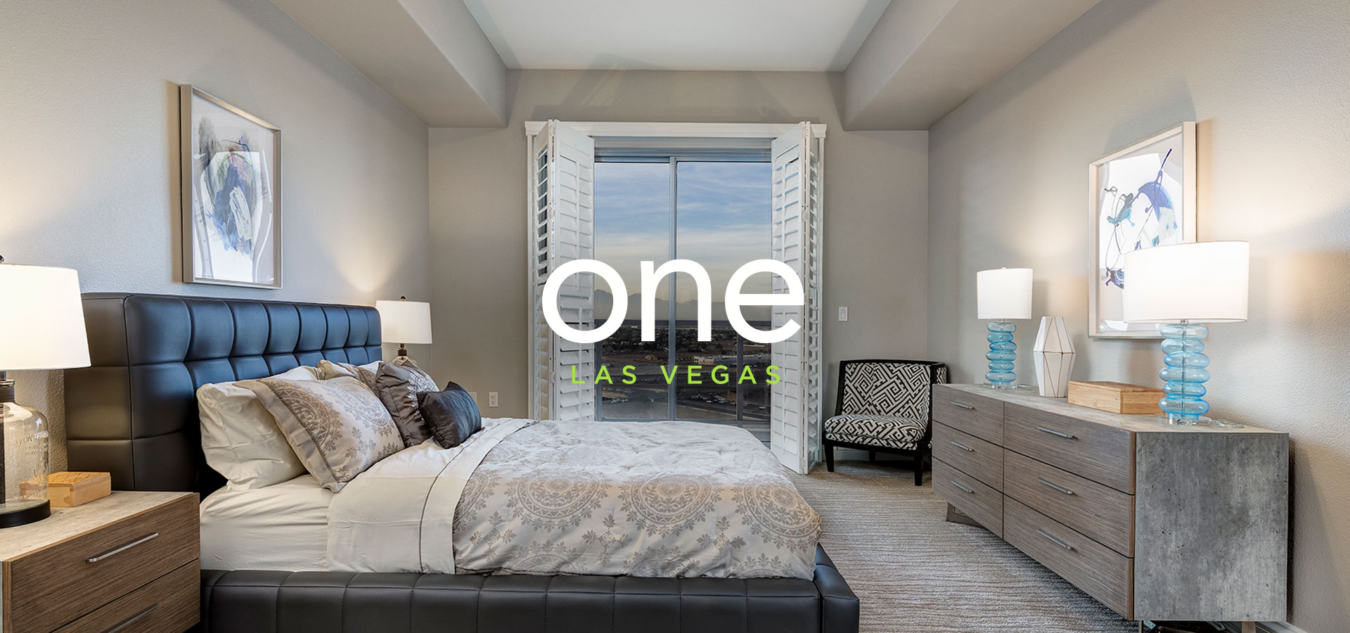 Bedroom in one of the model homes at One Las Vegas with text that reads 'One Las Vegas'