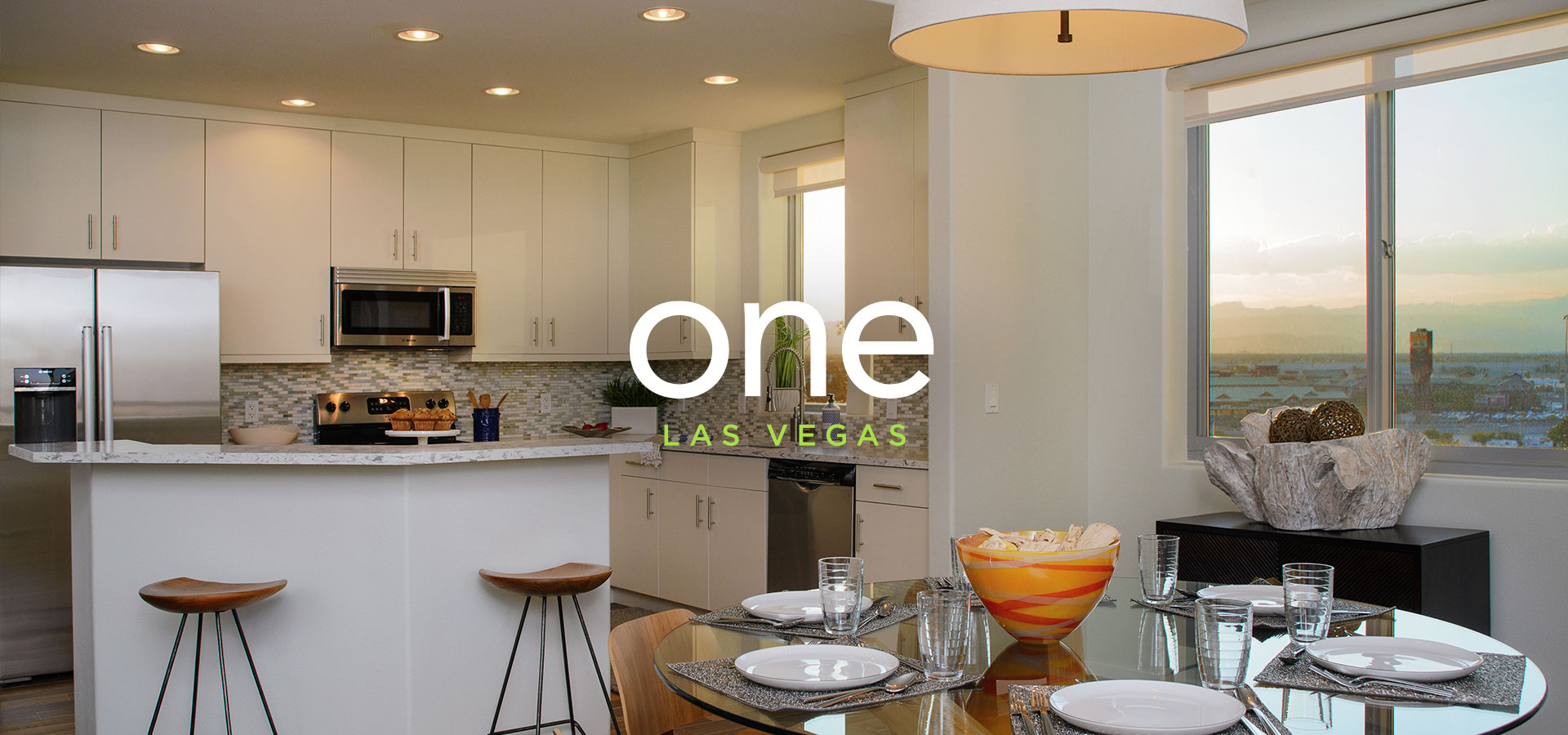 Kitchen and dining room table in one of the model homes at One Las Vegas with text that reads 'One Las Vegas'