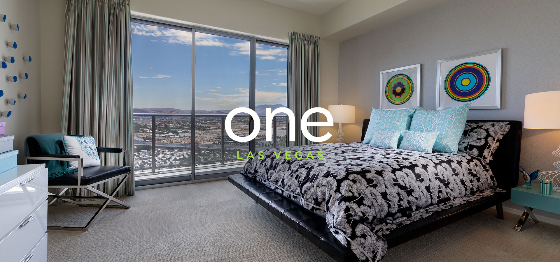 Bedroom inside on of the model homes at One Las Vegas with text that reads 'One Las Vegas'