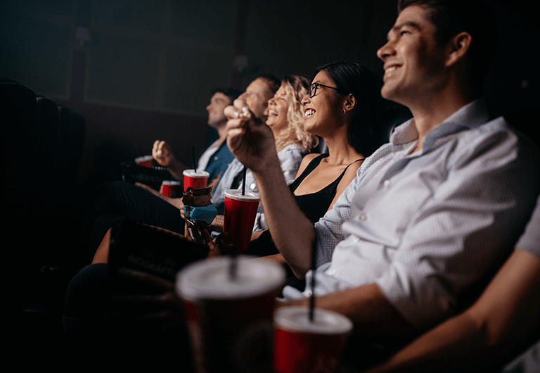 Group of friends enjoy a movie together.