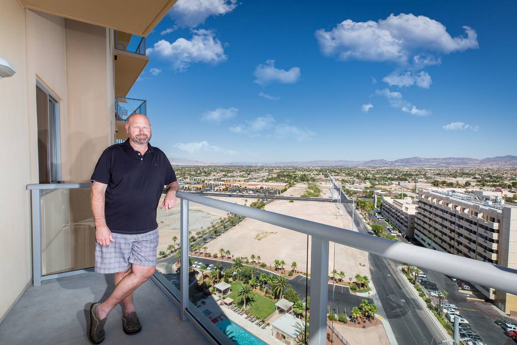 Resident Jon standing on the balcony of his One Las Vegas home
