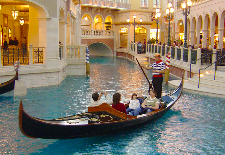 A gondolier taking tourists on a gondola ride at the Venetian in Las Vegas.