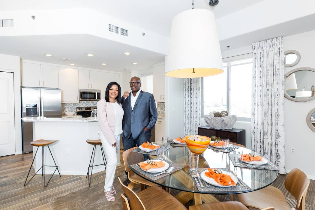 Residents Pam and Marcellus standing in the kitchen and dining room of their One Las Vegas home