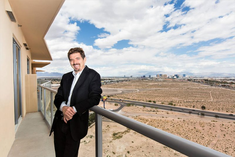 Resident Brice Cappelli standing on the balcony of his One Las Vegas home overlooking the Strip